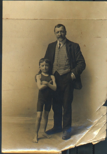 Jabez Wolffe's trainer Walter Brickett with young swimmer Jack Mace