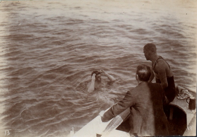Channel Swimmer Jabez Wolffe changing goggles