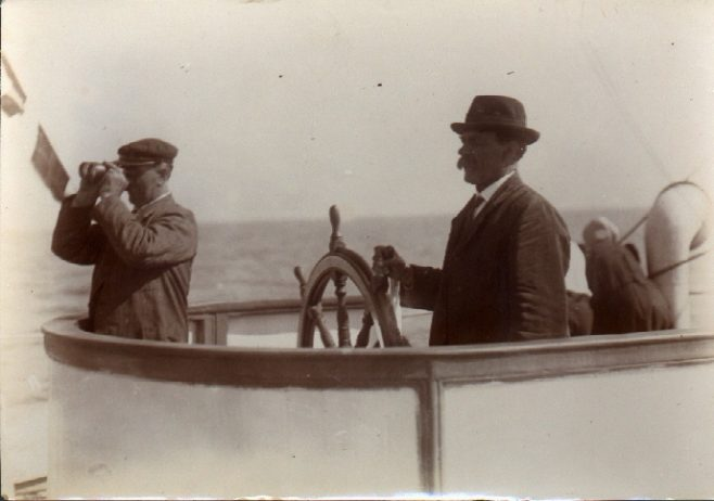 "Two members of Jabez Wolffe's team aboard the pilot boat. ""Dover Castle sighted"""