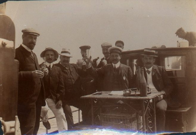 Jabez Wolffe's party drink a toast aboard the 'Sea Wolf'