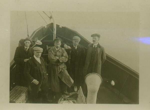 A Channel Swimmer's support team on board a tug. (Holbein?)