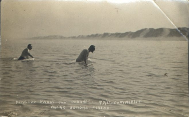 T. W. Burgess and another swimmer (Weidman?) wading ashore after his cross Channel swim