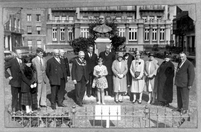 Joan Brunton receiving award in front of Capt. Webb Memorial