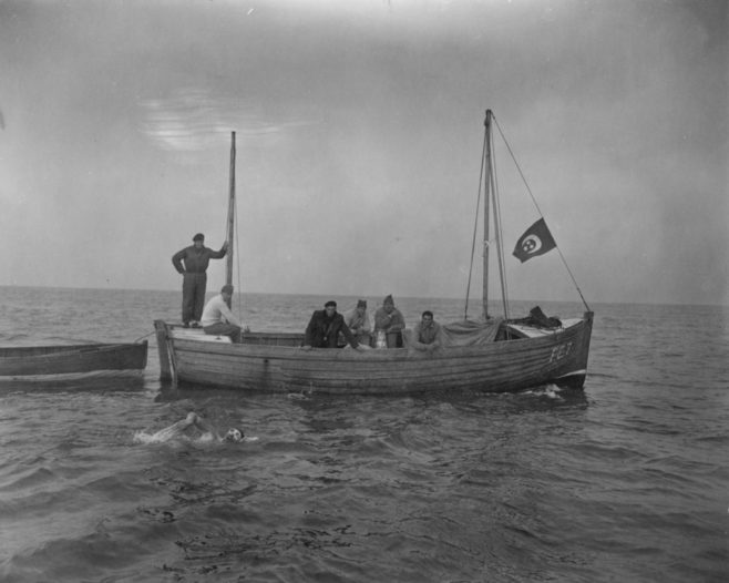 Folkestone fishing boat F E 7 with a swimmer.