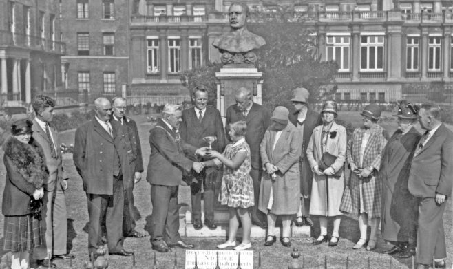 Photograph of Joan Brunton recieving cup from Mayor at the Webb Memorial