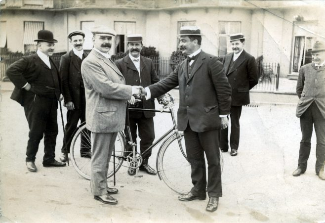 Photograph of Monty Holbein and Ted Heaton shaking hands