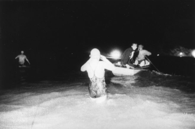 Photograph of Rosemary George entering the sea