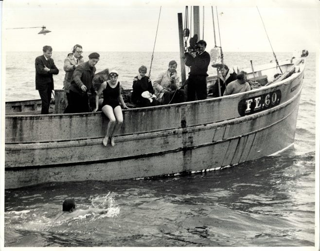 Unidentified Female Swimmer on Edge of the Boat 'FE.60 Opportunity'