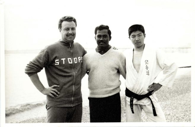 Three Swimmers on Sea Front - One In Martial Arts Outfit (Takaaki Vetsubbara) (unidentified)