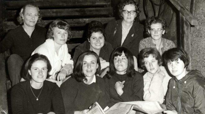 Ten Women relay team sitting on wooden stairs (unidentified)