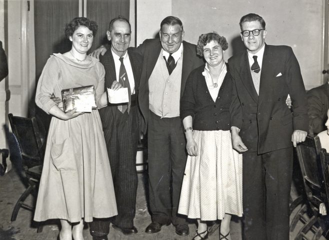 A Group Photograph; Jack Burwill, pilot, and others at a social