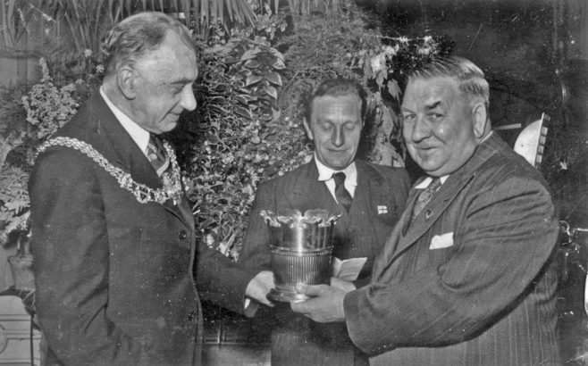Photograph of a trophy presentation (Jack Burwill) (unidentified)