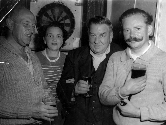 Photograph of Pop Burvill drinking with friends