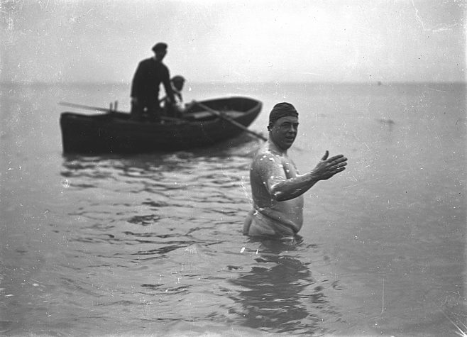 Henry Sullivan (Channel Swimmer) walking into the sea at Shakespeare Cliff