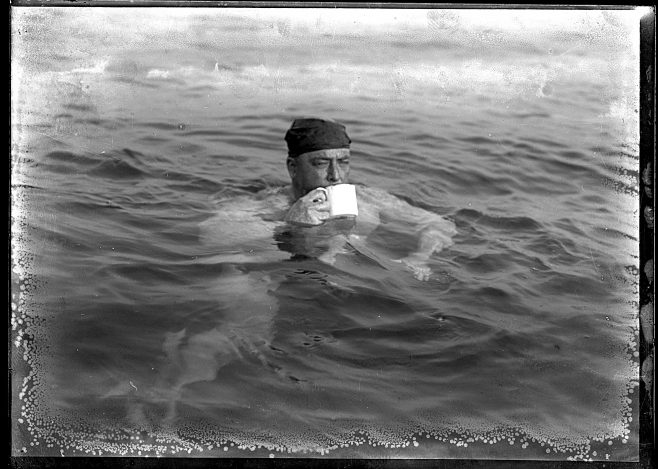 Channel swimmer Henry Sullivan taking a drink whilst in the sea.