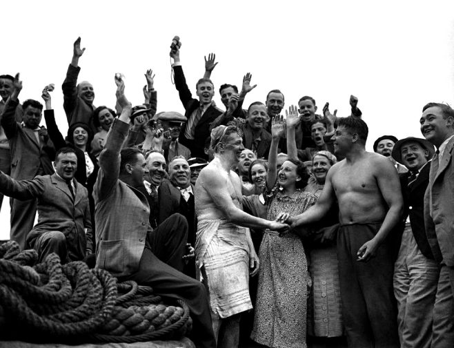 Tom Blower, left, congratulated by Ted Temme on Aug. 4, 1937 in Dover